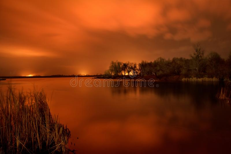 Fire in the floodlands on the river. Night photo. Dnieper River Delta. royalty free stock image