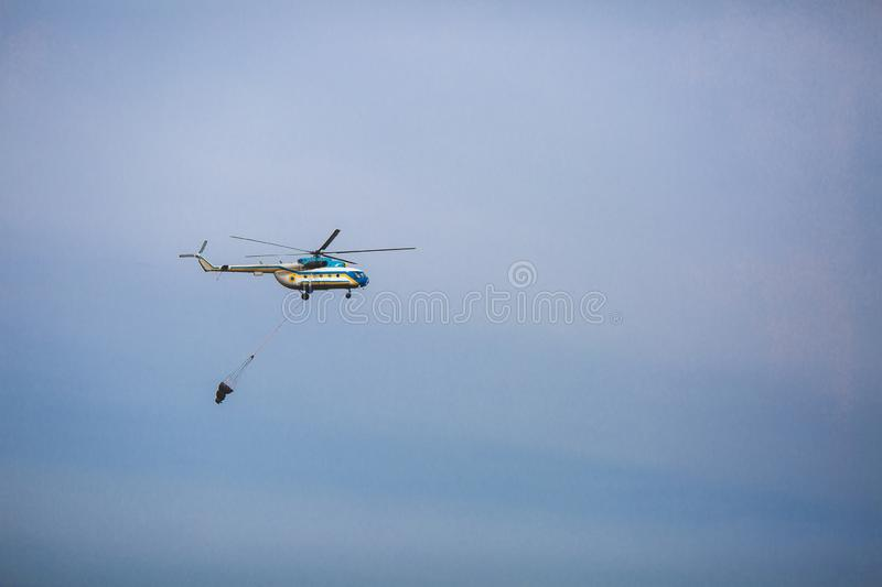 Fire in forest. Helicopter dpirs and drops water in epicenter of incident.  stock images