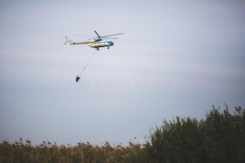 Fire in forest. Helicopter dpirs and drops water in epicenter of incident.  royalty free stock photos