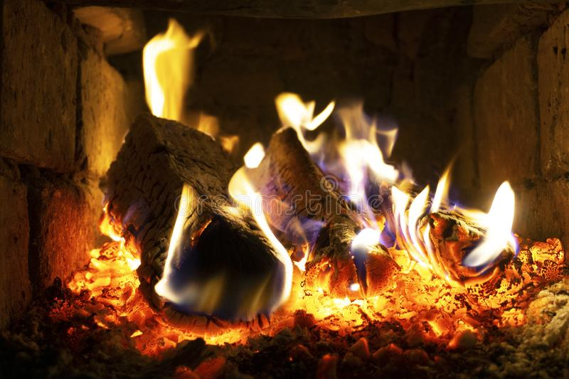 The fire in the furnace. Ember and fire close up. Coals, flames,  comfort, relax concept background royalty free stock photo