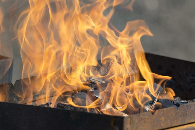 The fire in the grill. bbq grill flame, hot burning grill. Outdoors royalty free stock photo