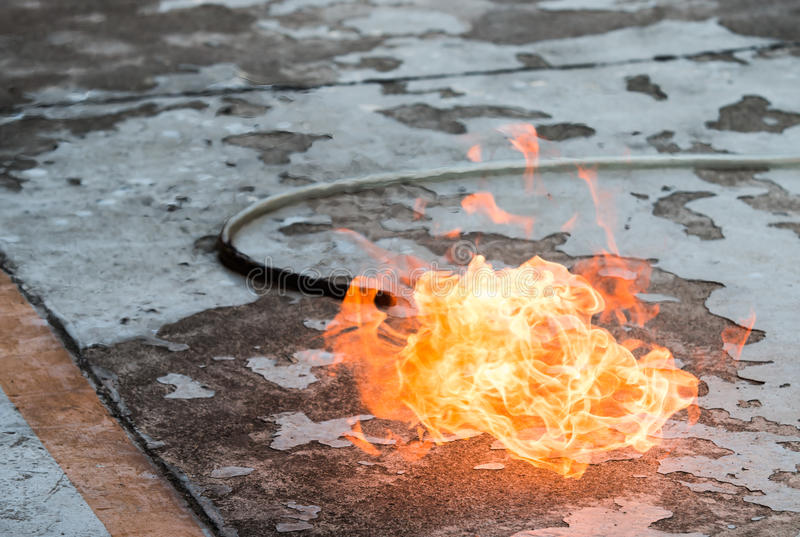 A fire on the ground due to a gas leak. Dangerous stock photography
