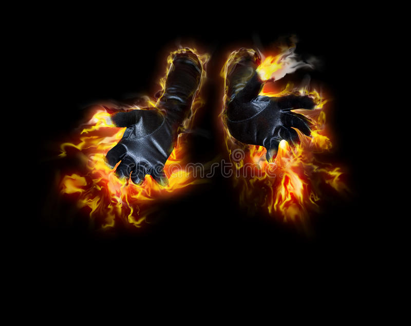 Fire hands. A pair of black satin gloves on fire reaching forward. Concept for presenting hot new merchandise