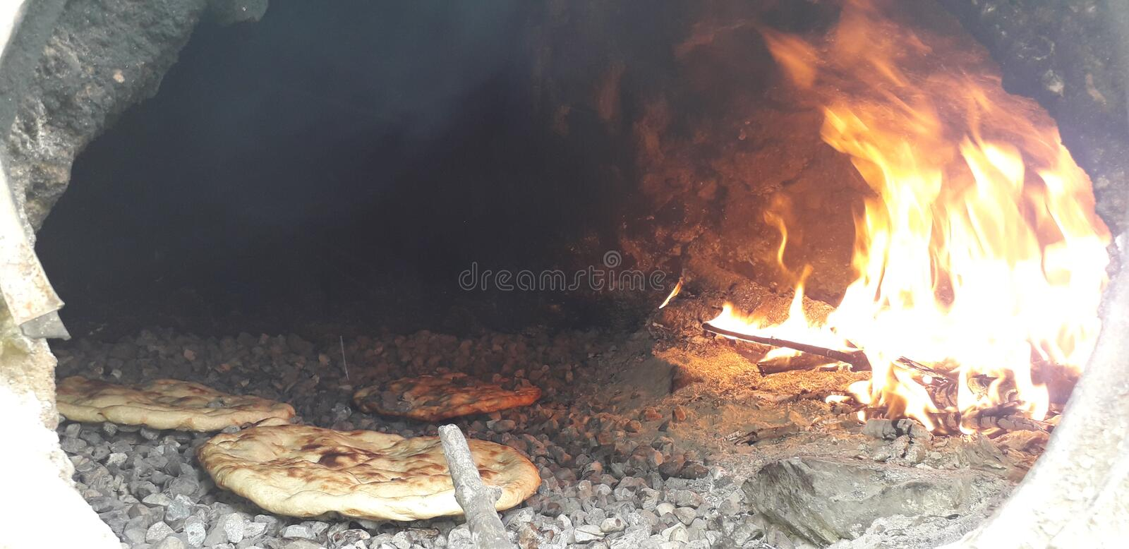 Fire has the well-being of healthy and good faith in good quality. Cooking, traditional, oven, healthy, good royalty free stock image