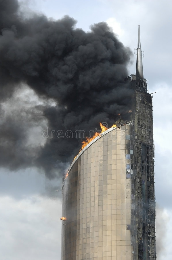 Fire on high-altitude building stock image