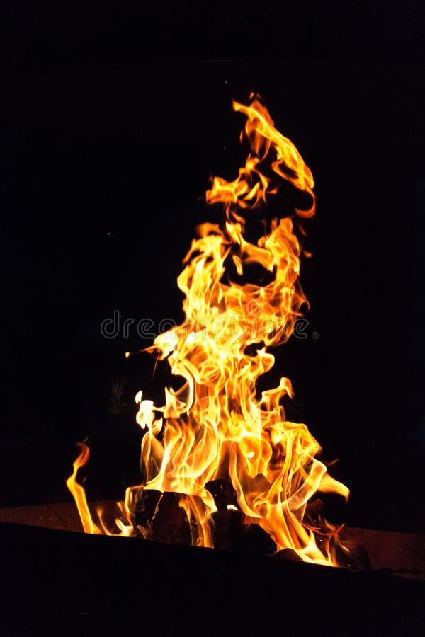 The fire of the Holy Inquisition. Devilish flame. The fire of hell. Background from dancing tongues of fire. Fire hazard. Fire safety. Passionate love. Bask royalty free stock photo
