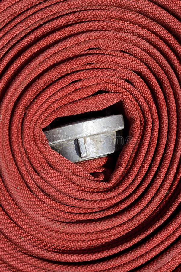 Fire hose. Fire tube rolled up, close-up royalty free stock photo