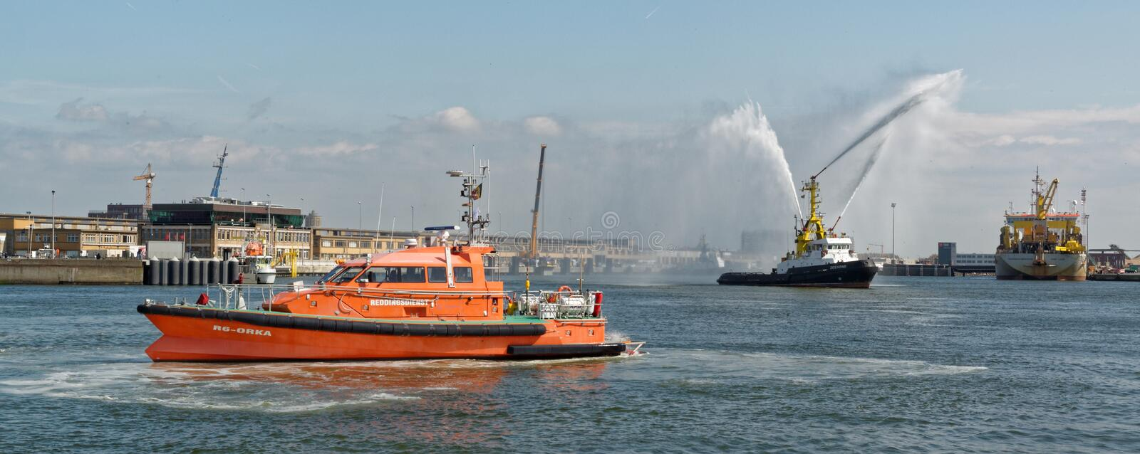 Fire hose boat `The Zeehond` spraying water in Oostende royalty free stock photo