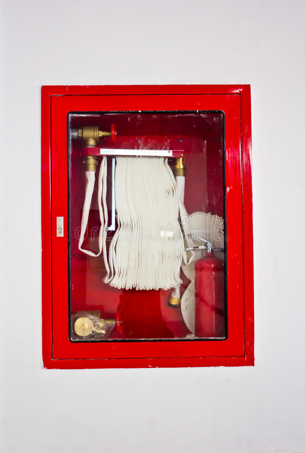 Fire hose in the box. Hanging on wall royalty free stock image
