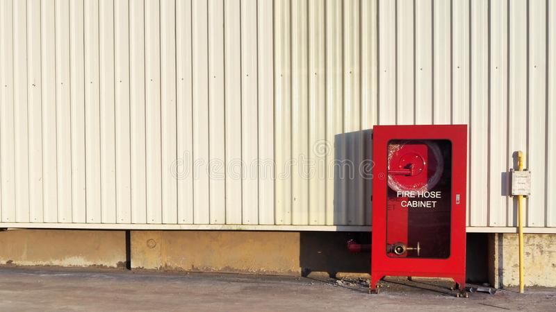 Fire Hose Cabinet Installed Outdoor. Of The Factory royalty free stock image