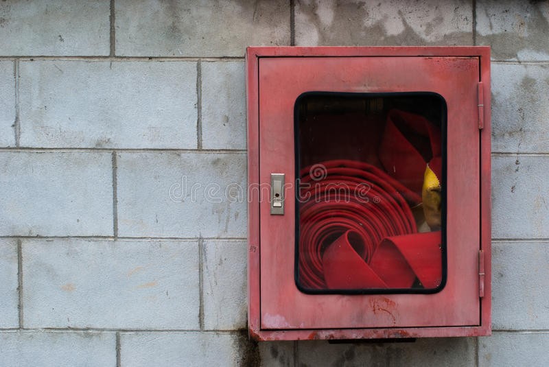 Fire Hose Cabinet. In the red box on the wall royalty free stock photos