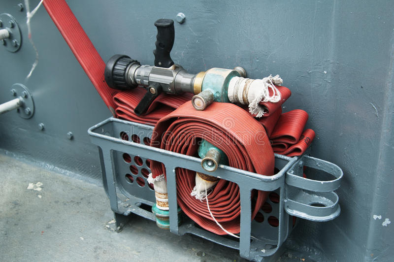 Fire hose on a deck of ship royalty free stock photos