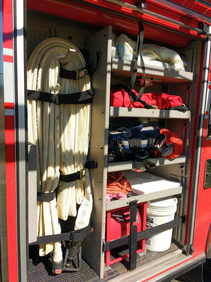 Fire Hose, Firefighting Equipment in a Fire Truck, Rutherford, NJ, USA. This example of how firefighting equipment is stored on a fire truck was on display royalty free stock image