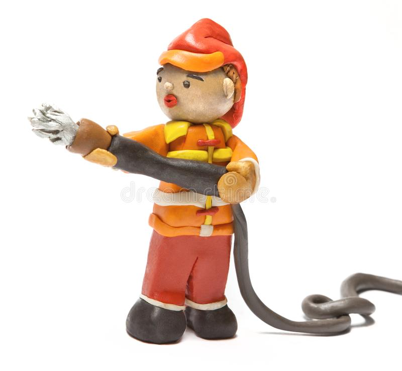 Fire with a hose, made of plasticine. royalty free stock image