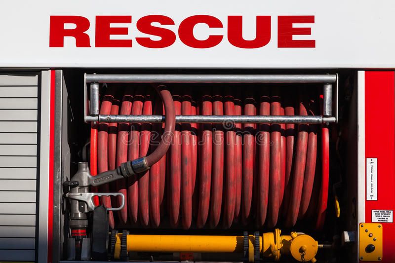 Fire hose. Mounted on a rescue fire engine royalty free stock image