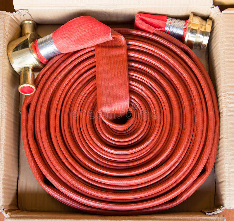 Fire hose. Red fire hose in Thailand stock image