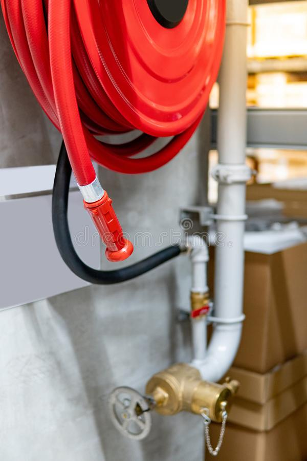 Fire hose reel and water gate for hydrant system. Red fire hose reel and water gate valve for hydrant system. Fire protection equipment in public building royalty free stock photos