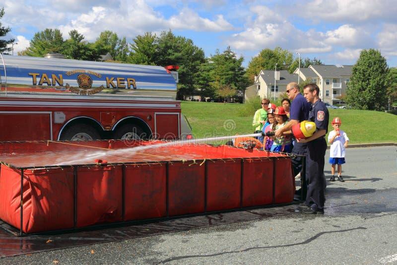 Fire Hose Training Kids stock photos