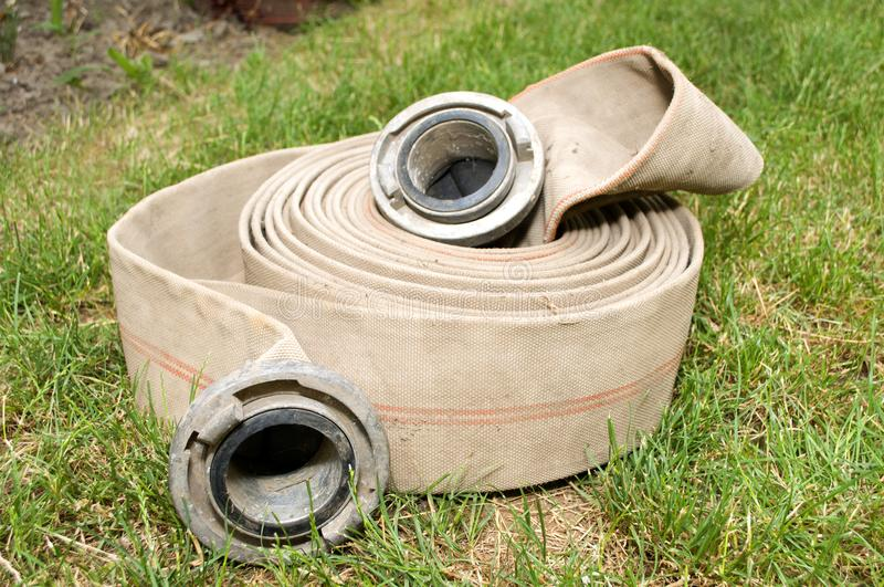 Fire hose for water. On grass royalty free stock photo