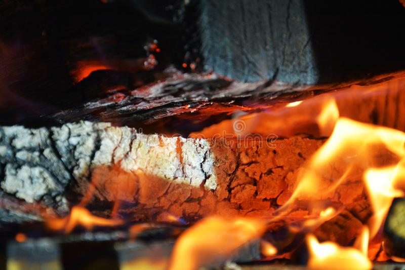 Fire, hot flames and wooden oven. Wood dark hard logs burning, orange flames and hot temperature royalty free stock images