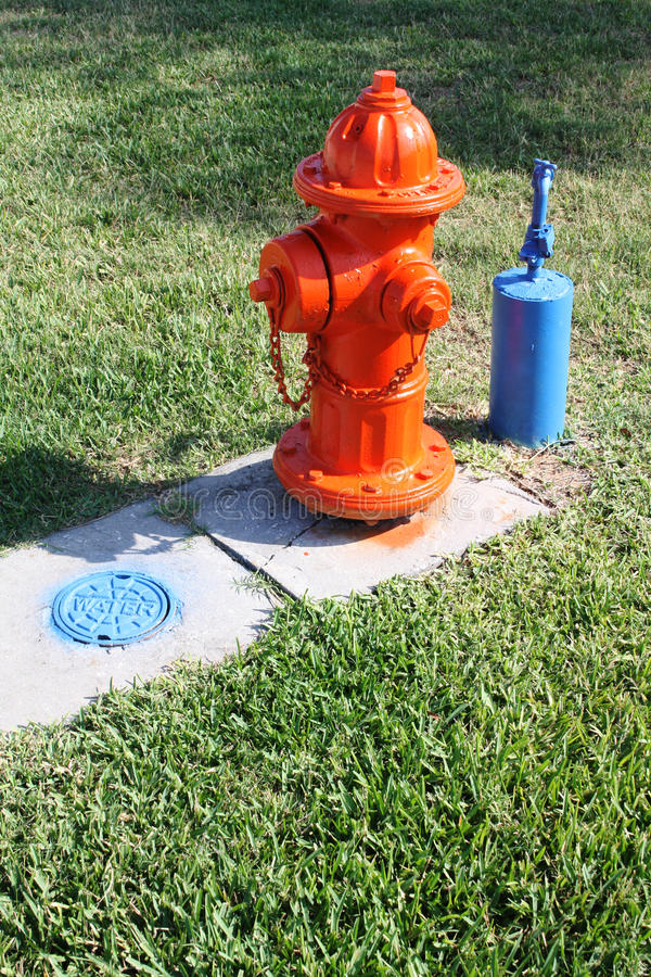 Fire Hydrant And Outside Water Tap And Grate Stock Images