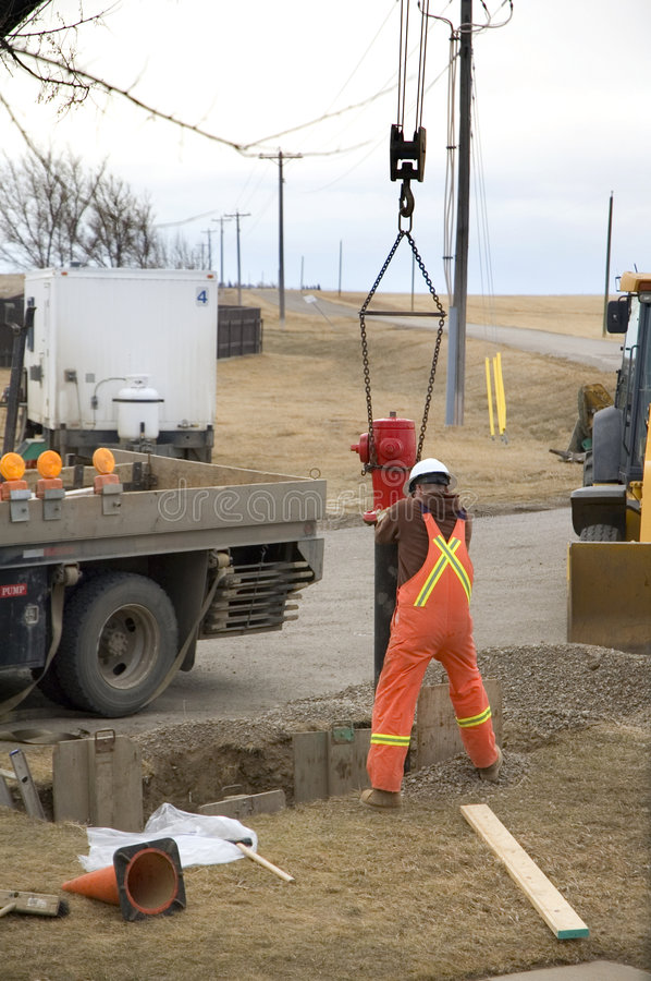 Fire Hydrant Replacement. City construction worker replacing a fire hydrant stock photos