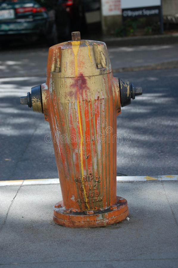 Fire hydrant splattered with paint in Portland, Oregon. This is a fire hydrant splattered with paint in Portland, Oregon royalty free stock image