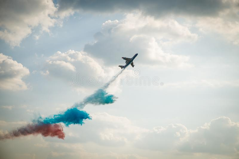 Fire hydroplane Be 200 Beriev 200 throwing down water of Russian flag at the Aerospace Show MAKS royalty free stock image