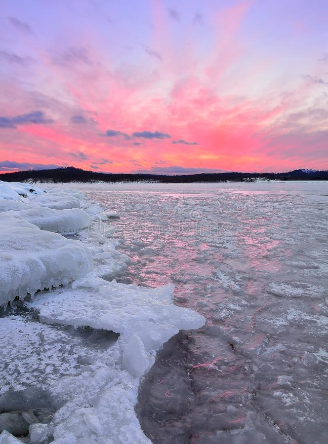 Fire and Ice. A beautiful sunset over frozen Seneca Lake, Ohio with colorful light reflecting from shards of ice stock photography