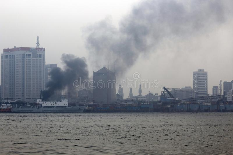 FIRE INCIDENT AT BALOGUN MARKET TWO DAY TO CHRISTMAS, LAGOS NIGERIA. SMOKE BILLOW FROM A BURNT BUILDING AT BALOGUN MARKET LAGOS NIGERIA royalty free stock images
