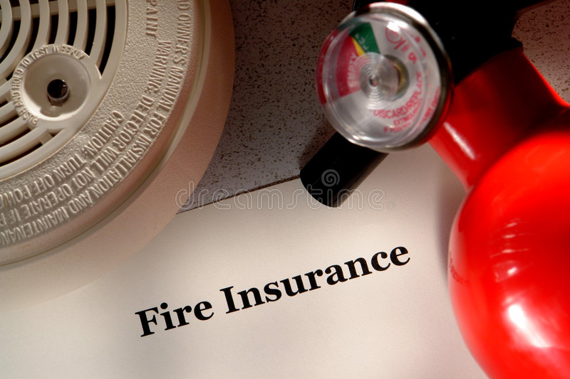Fire Insurance Document and Safety Extinguisher royalty free stock photos
