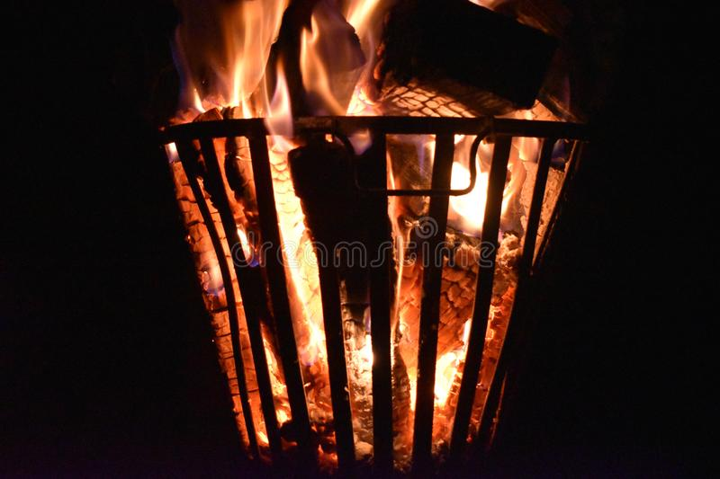 Fire in an iron fire pit. That is fully filled with blocks royalty free stock photos