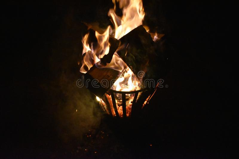 Fire in an iron fire pit stock images