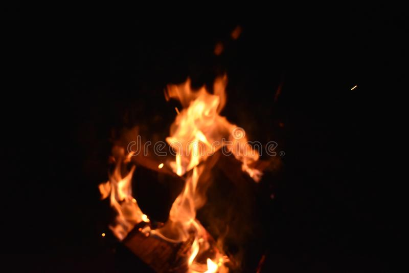 Fire in an iron fire pit. That is fully filled with blocks stock image