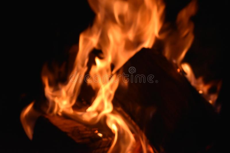 Fire in an iron fire pit. That is fully filled with blocks royalty free stock images