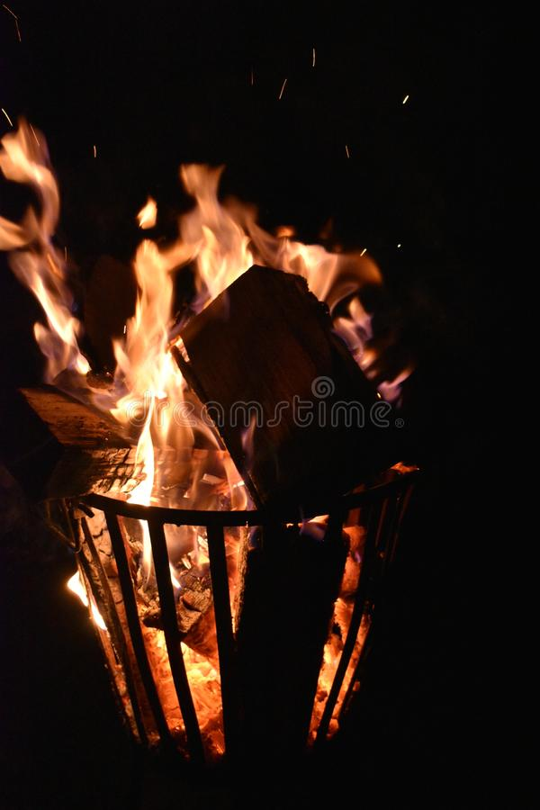 Fire in an iron fire pit. That is fully filled with blocks stock photos
