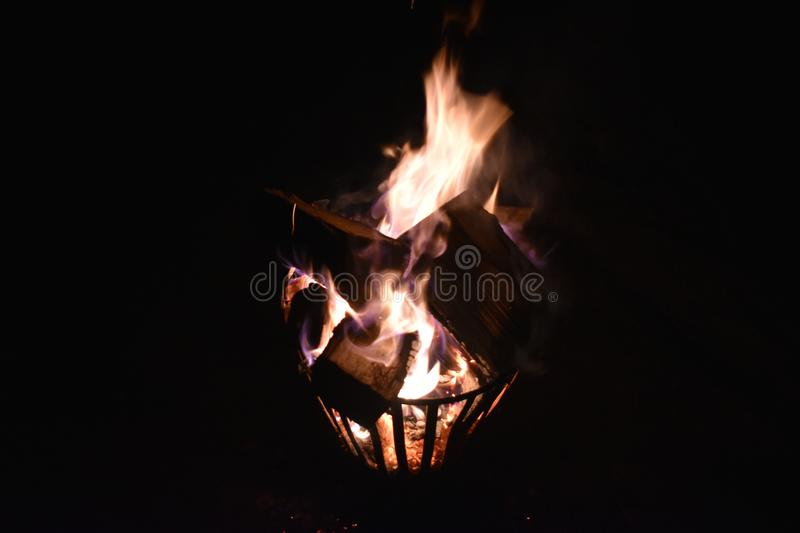 Fire in an iron fire pit stock photo