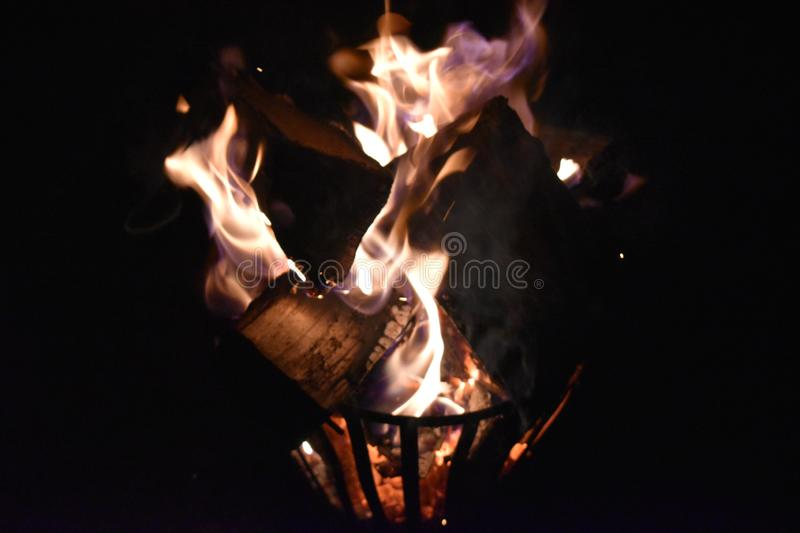 Fire in an iron fire pit. That is fully filled with blocks royalty free stock photo