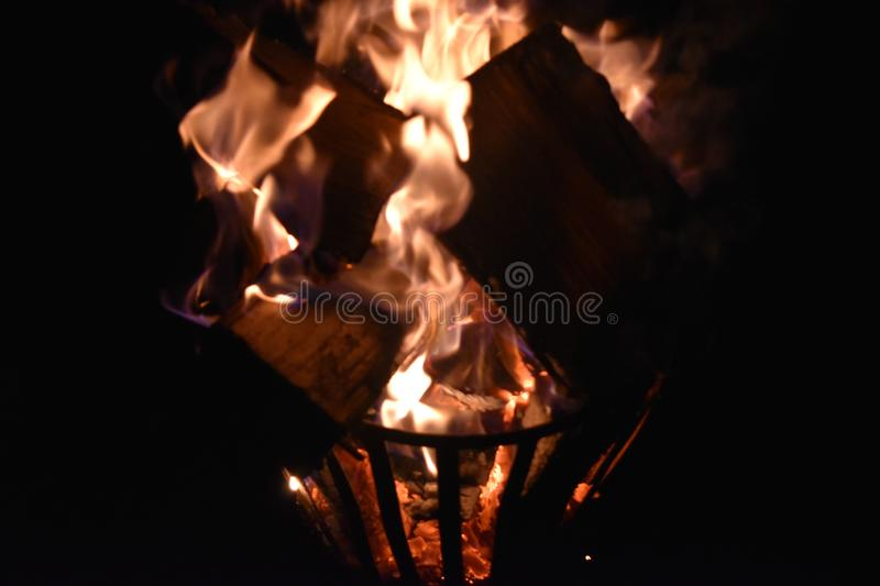 Fire in an iron fire pit. That is fully filled with blocks royalty free stock photography