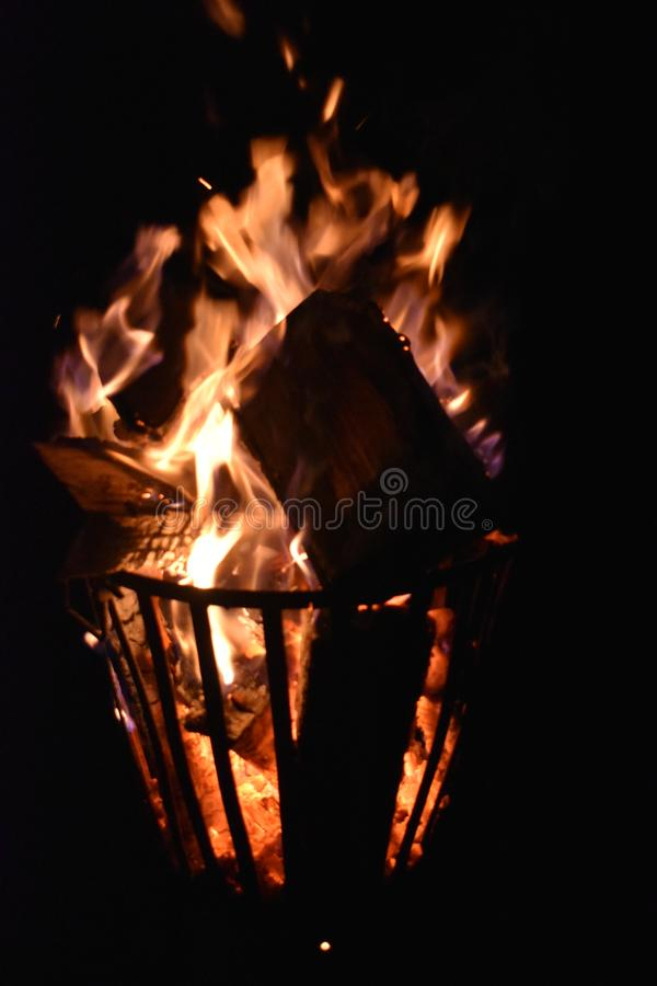 Fire in an iron fire pit. That is fully filled with blocks stock images