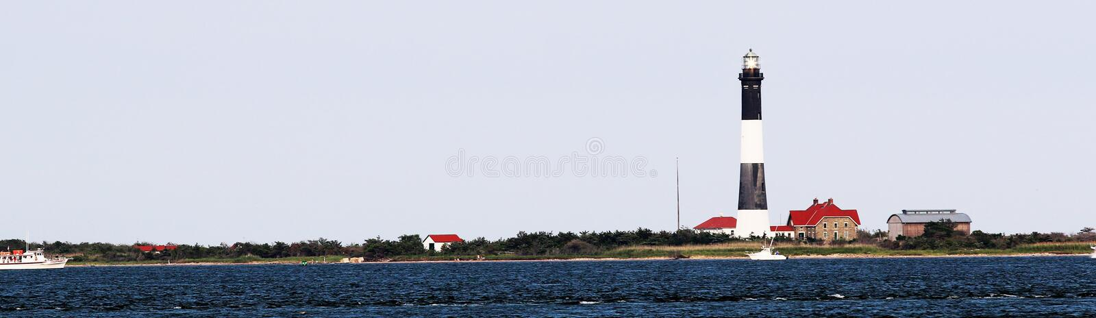 The Fire Island Lighthouse from the Bay side. The Fire Island Lighthouse taken from behind on a very windy day stock photo