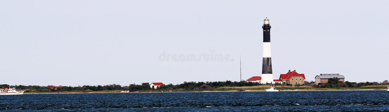The Fire Island Lighthouse taken from the bay side. The Fire Island lighthouse on a rough day taken from the great south bay side stock images