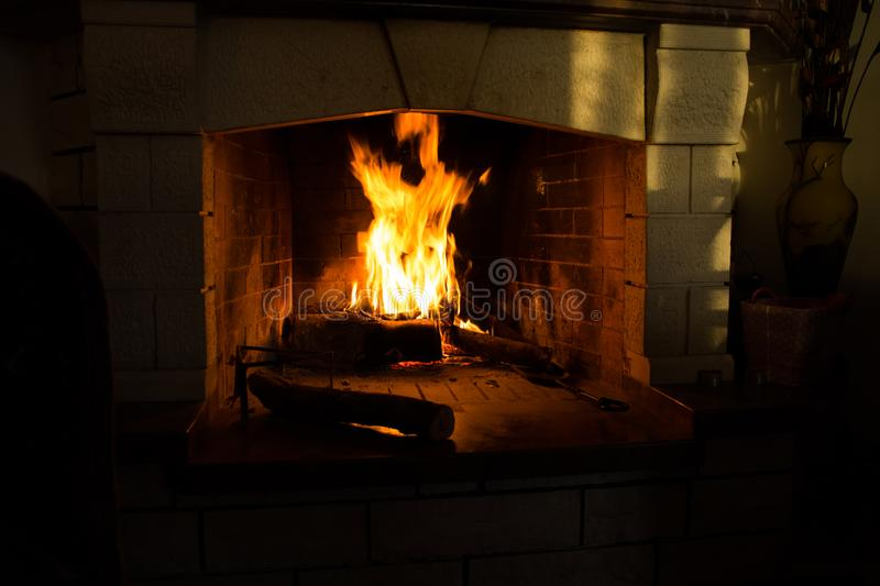 Fire isolated in black woods fireplace for background stock photos