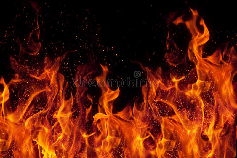 Fire isolated over black background stock photos