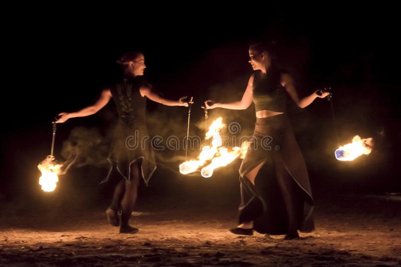 Fire juggers in the dark. SZEGED, HUNGARY - OCTOBER 31. 2018 - Fire Fantasy fire juggler group in Szeged Zoo stock images