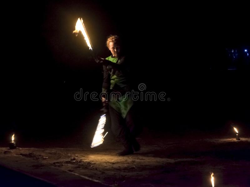 Fire juggers in the dark. SZEGED, HUNGARY - OCTOBER 31. 2018 - Fire Fantasy fire juggler group in Szeged Zoo stock photography