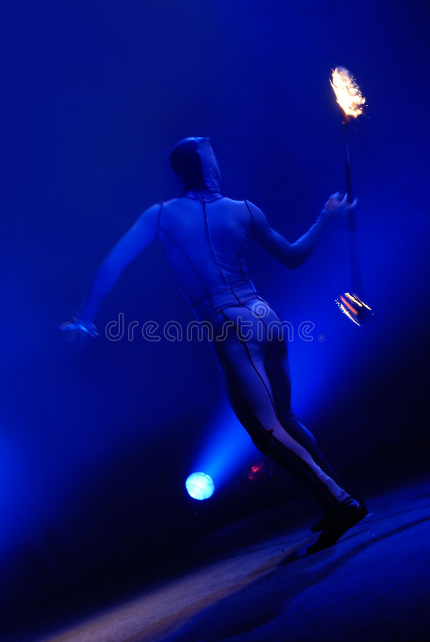 Fire juggler. Act on stage stock images