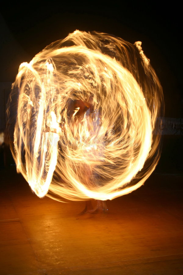 Fire juggler. A female fire juggler royalty free stock image