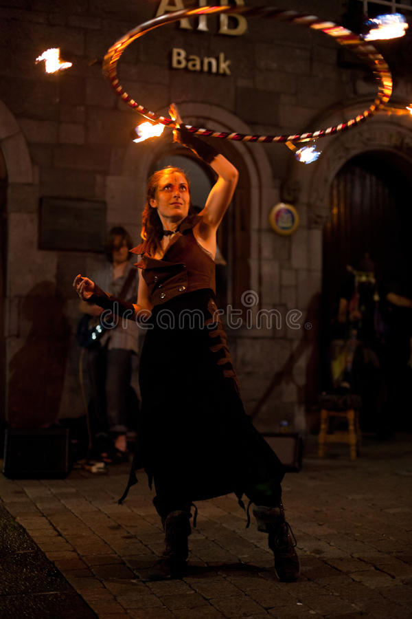 Fire juggler. GALWAY, IRELAND - JULY 5: Unidentified Fire juggler performs on streets of Galway during Volvo Ocean Race 2011-12 Festival, on July 5, 2012 in royalty free stock photos