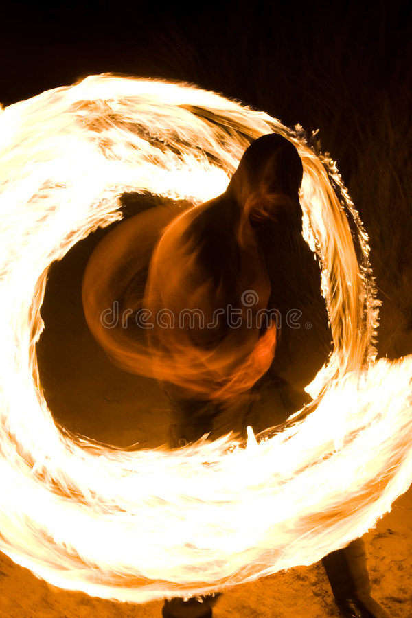 Fire juggler. Fire juggling on a beach at night stock photo